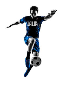 39630383 - one italian soccer player man playing football jumping in silhouette white background